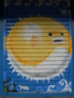 Le diodon, le poisson préféré de notre famille, ici peint sur une devanture de magasin à Papeete